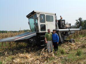 Jason Brewer and Dr. Sun Hee Woo combining corn